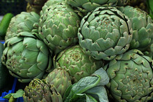 Green Fresh Globe Artichokes On Market Display
