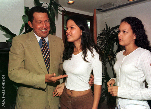 Candidate for president of Venezuela, Hugo Chavez (L), introduces his daughters Maria (C) and Rosa t..