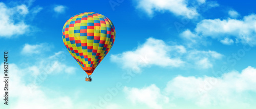 Tuinposter Ballon Hot-air balloon and blue sky and white clouds