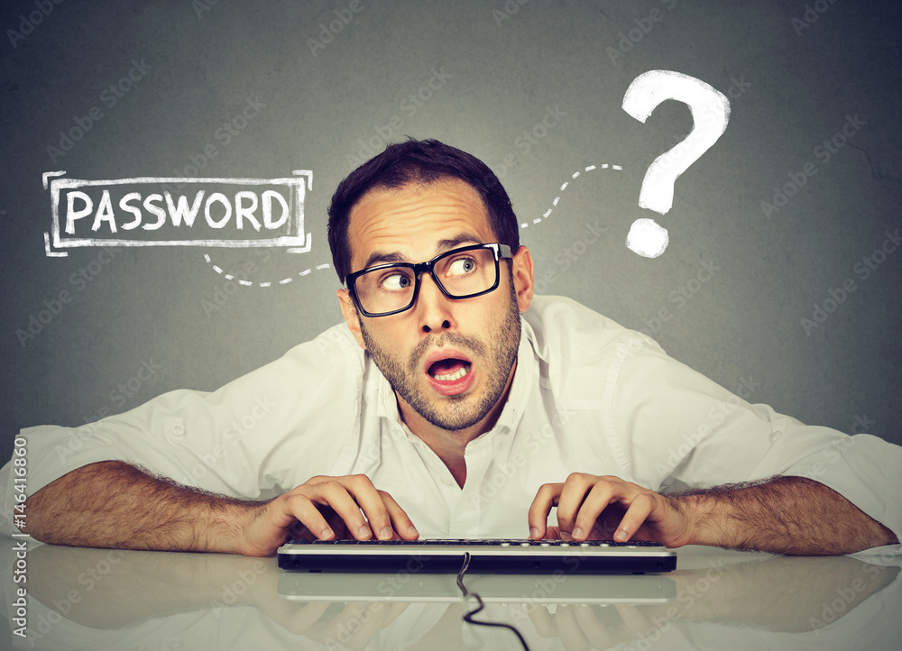 Fototapeta Man typing on the keyboard trying to log into his computer forgot password
