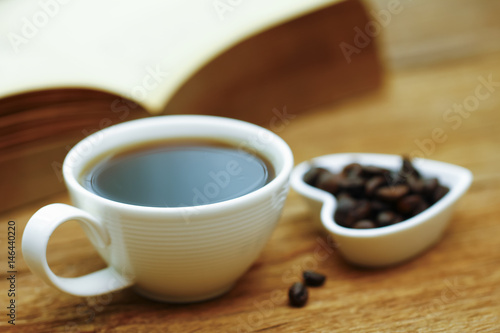 In de dag Chocolade Stock Photo - Coffee cup & book on wood table - vintage (retro) style color effect with soft focus