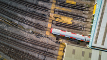 London Underground Tube Train Depot. Aerial Drone Photo Looking Down Onto A Train Emerging From A Depot.