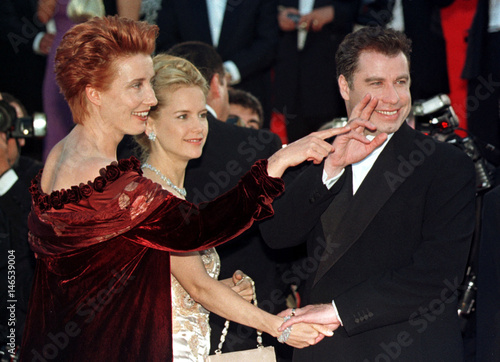 British actress Emma Thompson (L) and US actor John Travolta (R