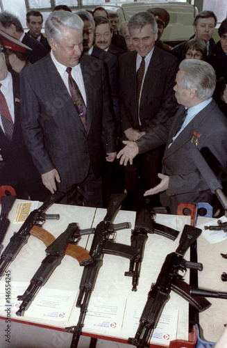 Russian President Boris Yeltsin (L) listens famous weapon