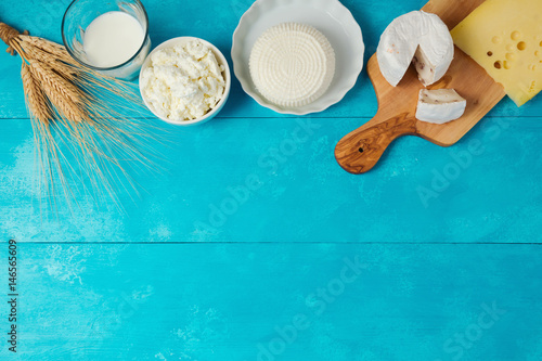 Fotobehang Zuivelproducten Milk and cheese, dairy products on wooden blue background. Jewish holiday Shavuot concept. View from above