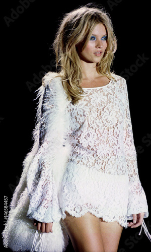 A model shows off a dress for Gucci during the 96 Spring/Summer fashion show in Milan October 7.