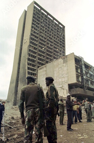Kenyan soldiers watch workers at the U S  embassy compound