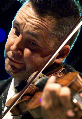 British violinist Nigel Kennedy performs during a