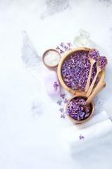 Obraz na płótnie Canvas Massage and spa products with lilac flowers