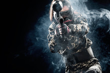 Heavily Armed Masked Paintball...