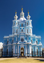 Russia, St. Petersburg. Smolny Cathedral (Church Of The Resurrection). Cathedral Facade. Clear Blue Sky.
