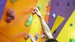 Man Climbing Up On Color Practice Wall Indoor