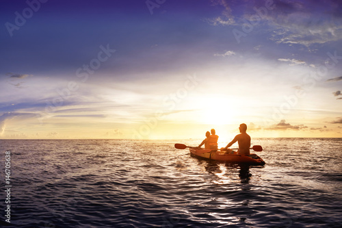 Family with child swims on kayak
