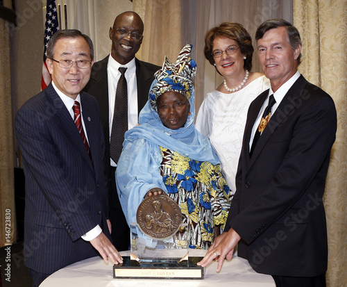 U.N. Secretary General Ban Ki-moon, Malick Diagne, Ouyere Sall, Molly  Melching and Steven Hilton pose in front of the Conrad Hilton Humanitarian  Prize ... 056ca012d2