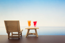Wooden Beach Chairs Or Sun Loungers With Glass Of Oranges And Strawberry Juices On Balcony And Beautiful Sea View On Clear Day In Summer Season, Copy Space
