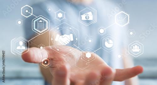 Fotografia  Businessman using digital presentation for partnership business 3D rendering
