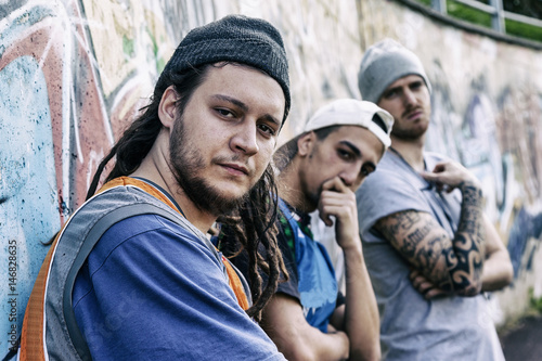 Fotografie, Obraz  three rap singers in a subway with graffiti in the background