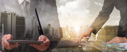 Fotografía  Double exposure of success businessman working in office with digital tablet lap