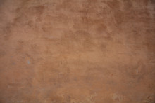 Stucco Painted Wall Background Texture, Brown Color, Exterior Building Facade In Italy