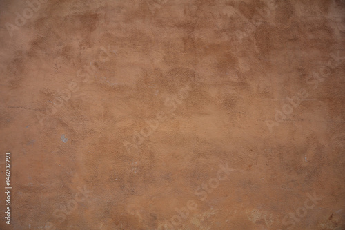 Cuadros en Lienzo Stucco painted wall background texture, brown color, exterior building facade in