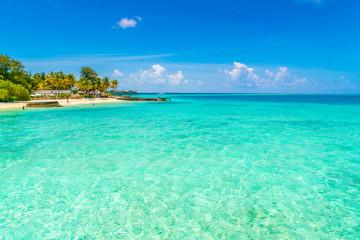 Beautiful tropical Maldives island with white sandy beach and sea .