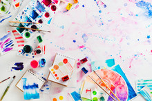 Feminine Artist Workplace With Watercolor Palettes And Color Circle