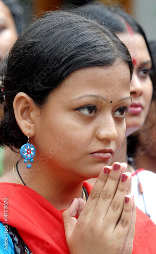Bangladeshi Hindu woman worships a virgin girl called