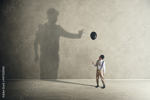 man and shadow with black balloon Wallpaper Mural