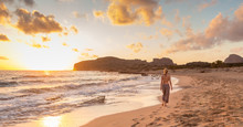 Woman Walking On Sandy Beach A...
