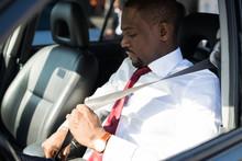 Man Fastening The Safety Belt