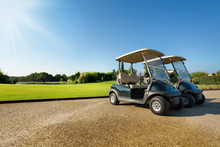Two Golf-carts Standing At The...