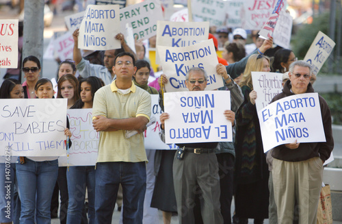 Pro-life advocates hold signs during a rally to protest against