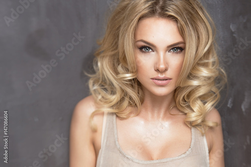Fotografie, Tablou  Sensual beautiful blonde woman over grey background