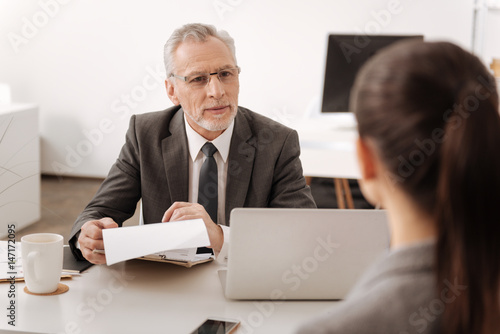 Kind male person looking at his secretary Fototapet