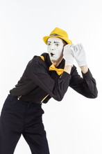 Man, Artist, MIME Holding Hand Near Ear And Listened. The Expression Of Human Emotions And The Concept Of Lifestyle. On A White Studio Background.