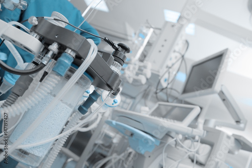 Fragment of breathing apparatus in the operating room filled with instruments an Canvas Print