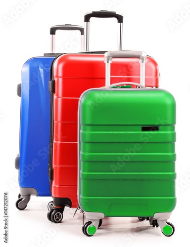 Fototapety, obrazy: Five plastic suitcases isolated on white