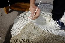 The Fisherman Repairs The Fishing Net