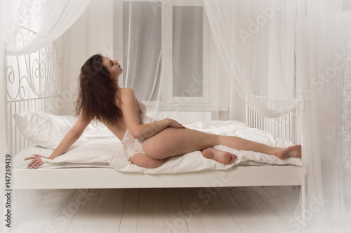 Valokuva  Sexual emotional attractive woman posing in a boudoir