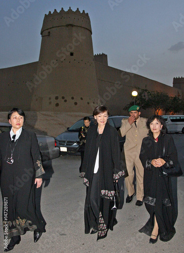Akie Abe, wife of Japan's Prime Minister Abe, walks in front of