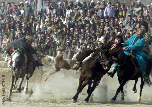 AFGHAN RIDERS STRUGGLE OVER GOAT CORPSE DURING BUZKASHI GAME IN