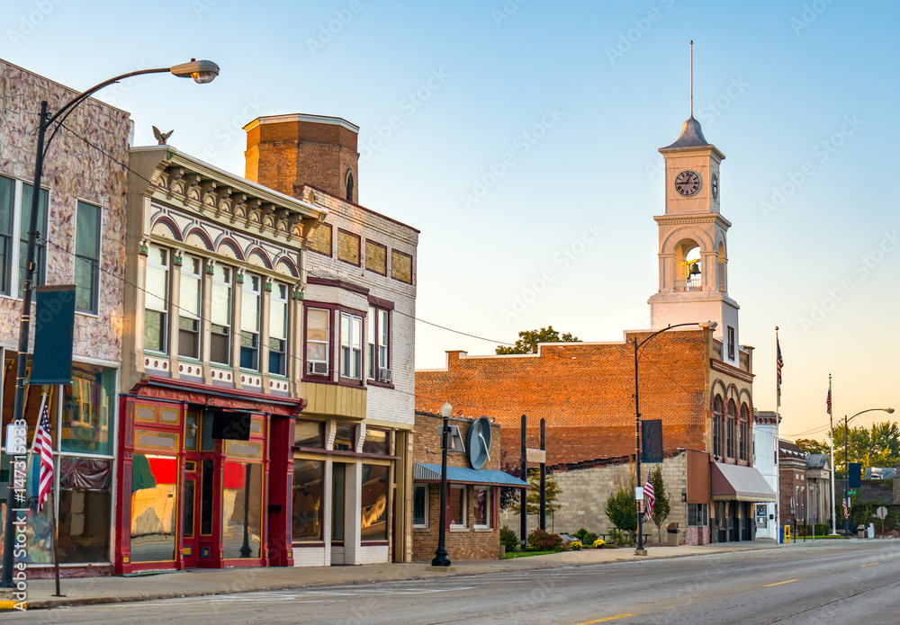 Fototapety, obrazy: Main street of rural small town in midwest USA with storefronts and clock tower