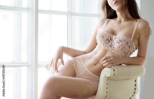 Fotografie, Obraz  Beautiful sexy lady in elegant white panties and bra