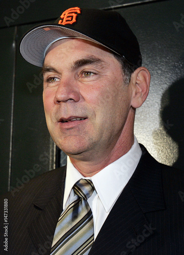 new arrival 39011 91bd1 Bochy wears San Francisco Giants baseball cap after being ...