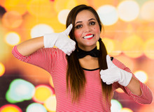 Closeup Portrait Of Cute Young Girl Clown Mime Holding Thumbs Up