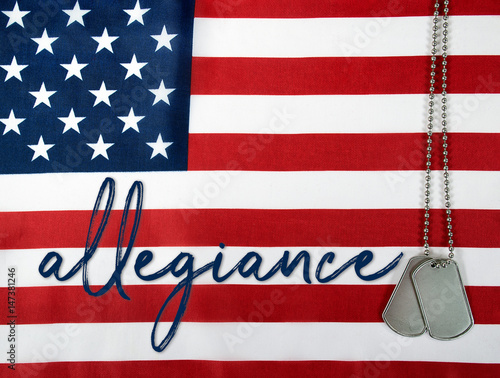 Photo word allegiance and military dog tags on American flag background