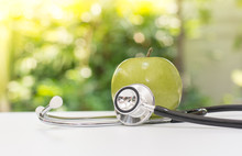 Green Apple With Stethoscope W...