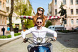 Couple in love riding a motorbike , Handsome guy and young sexy woman travel . Young riders enjoying themselves on trip.