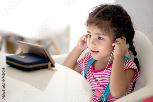 Fotografie, Obraz  asian girl concentrate on mobile