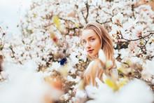 Beauty Woman Around Magnolia Pink Flowers Tree In Spring Garden